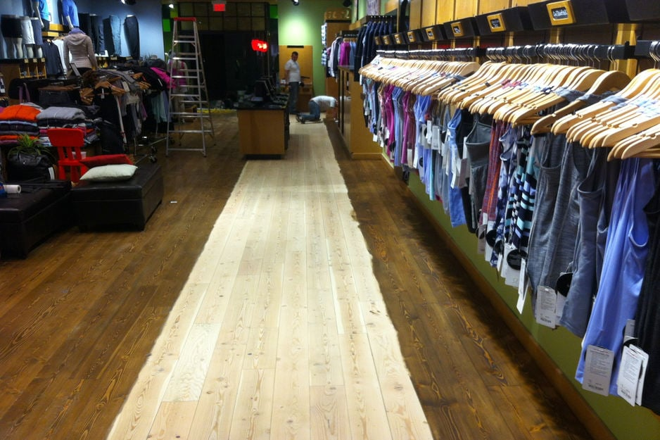 Hardwood floor refinishing - hardwood sanding, staining and refinishing at a commercial space, Lululemon store in London Ontario.