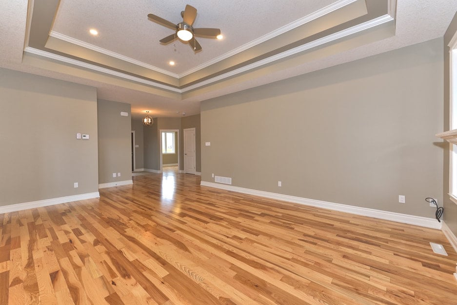 Dark hardwood floors in an open concept living room. A hardwood flooring installation or hardwood refinishing project in Ontario.