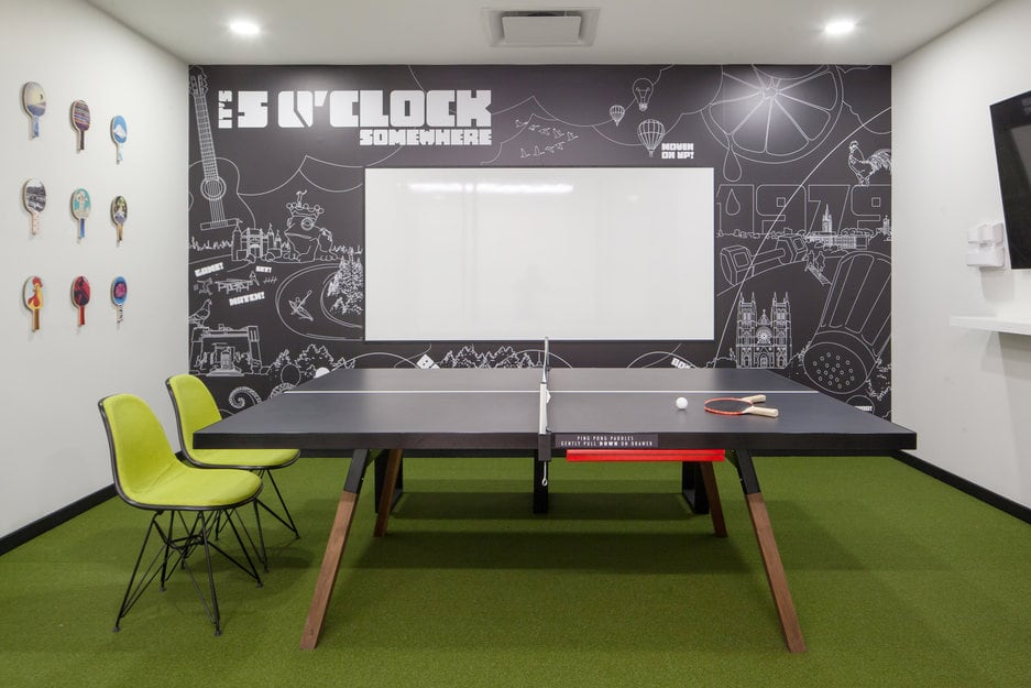 A green turf flooring installation project in a table tennis room of gym offices at Fit4Less gym in Ontario.