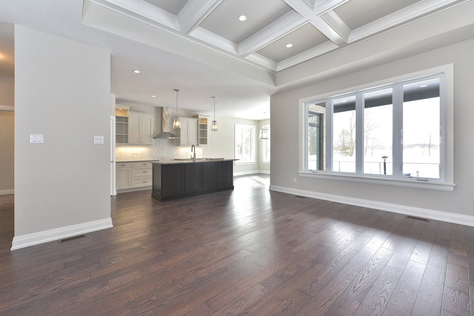 Dark hardwood floors in a modern kitchen. A hardwood flooring installation or hardwood floor refinishing project in London Ontario.
