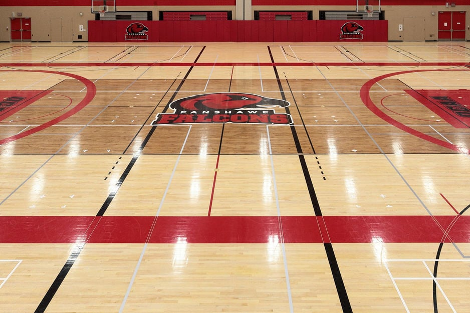 Gym flooring project at Fanshawe College in London Ontario. Gym hardwood floor sanding, staining and refinishing to rival the big leagues with painting and masking services for game line markings and custom graphic artwork logos, wordmarks, mascot incorporated into the gym floor finish - Fanshawe College Falcons mascot logo in the centre.